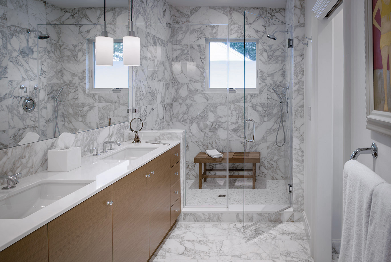 Marble and wood create this sharp and stylish bathroom