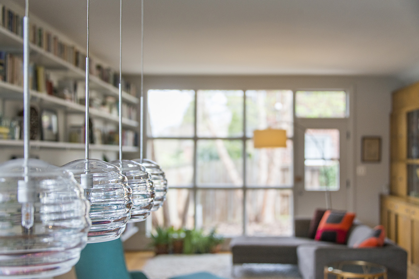 Hanging lamp fixtures add a beautiful detail to this mid-century modern home