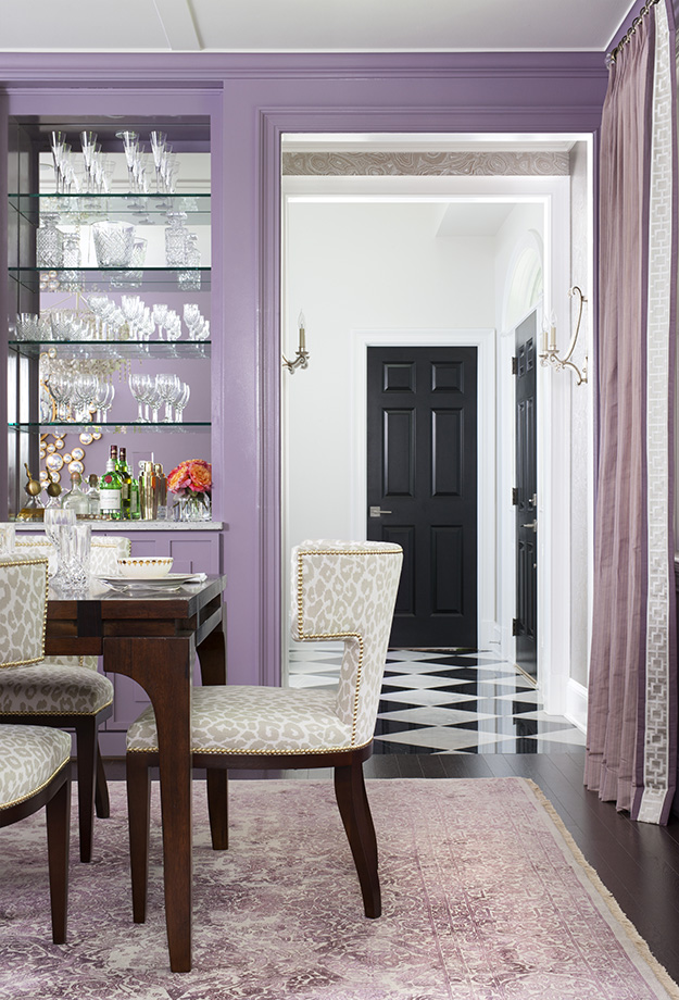 A warm and playful lavender dining room