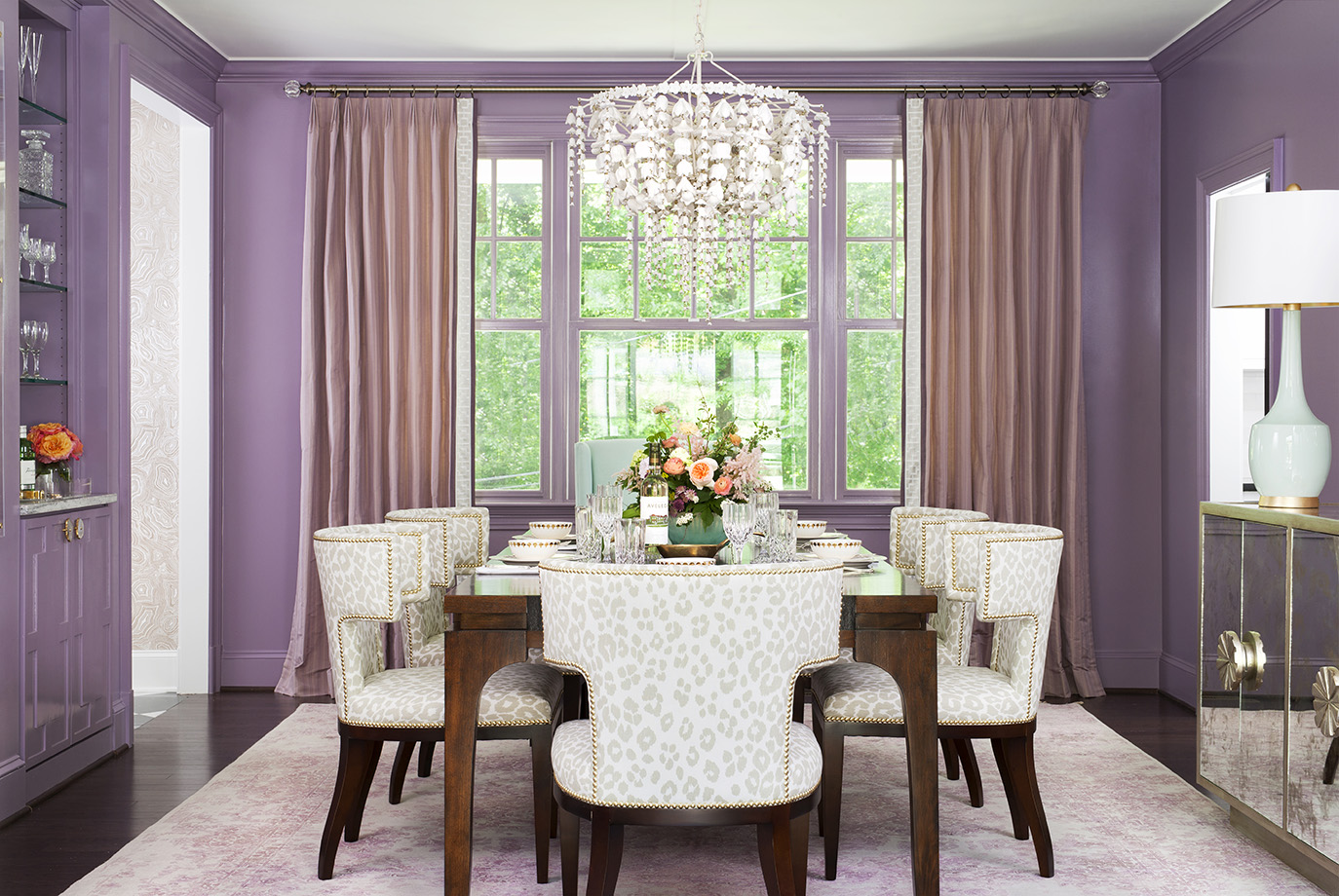 Passion and playful, this lavender themed dining room delights any dinner party