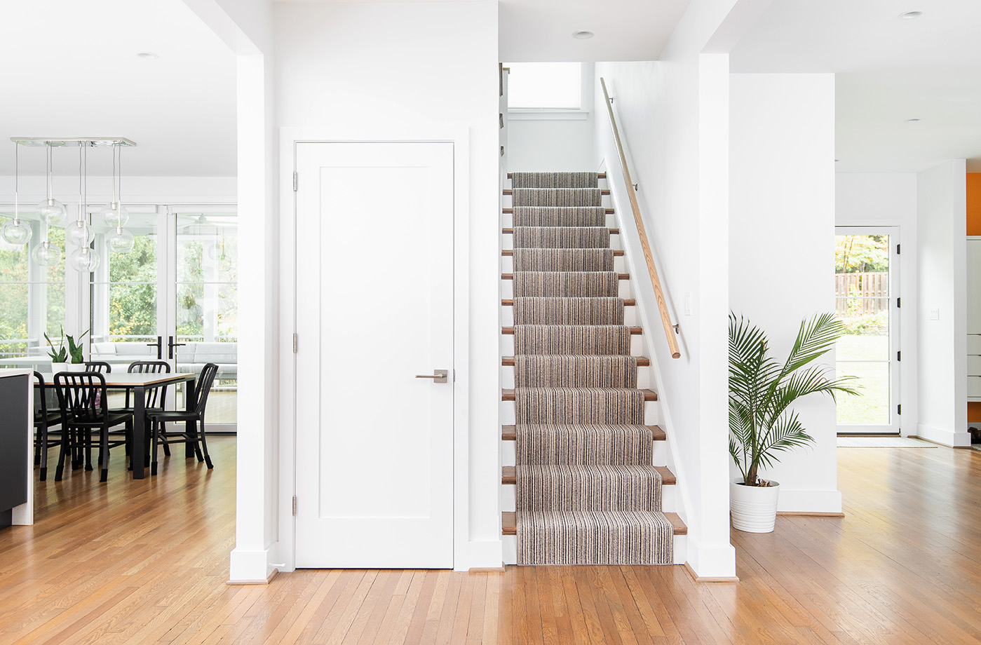 The grand stairway in this Colonial with a modern update