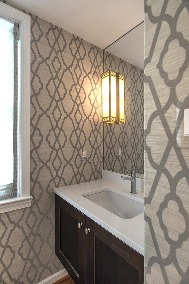 Wallpaper accents this half bath