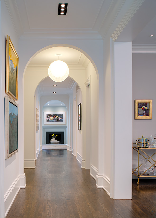 Arched hallway provides warmth and elegance