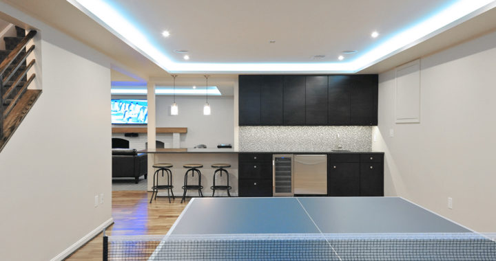 Interior renovation with a focus on basement recreation with a media room, ping pong and a bar