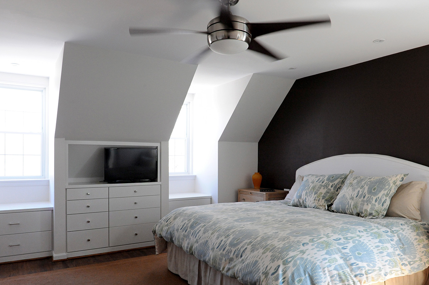 Cozy master bedroom with skylights