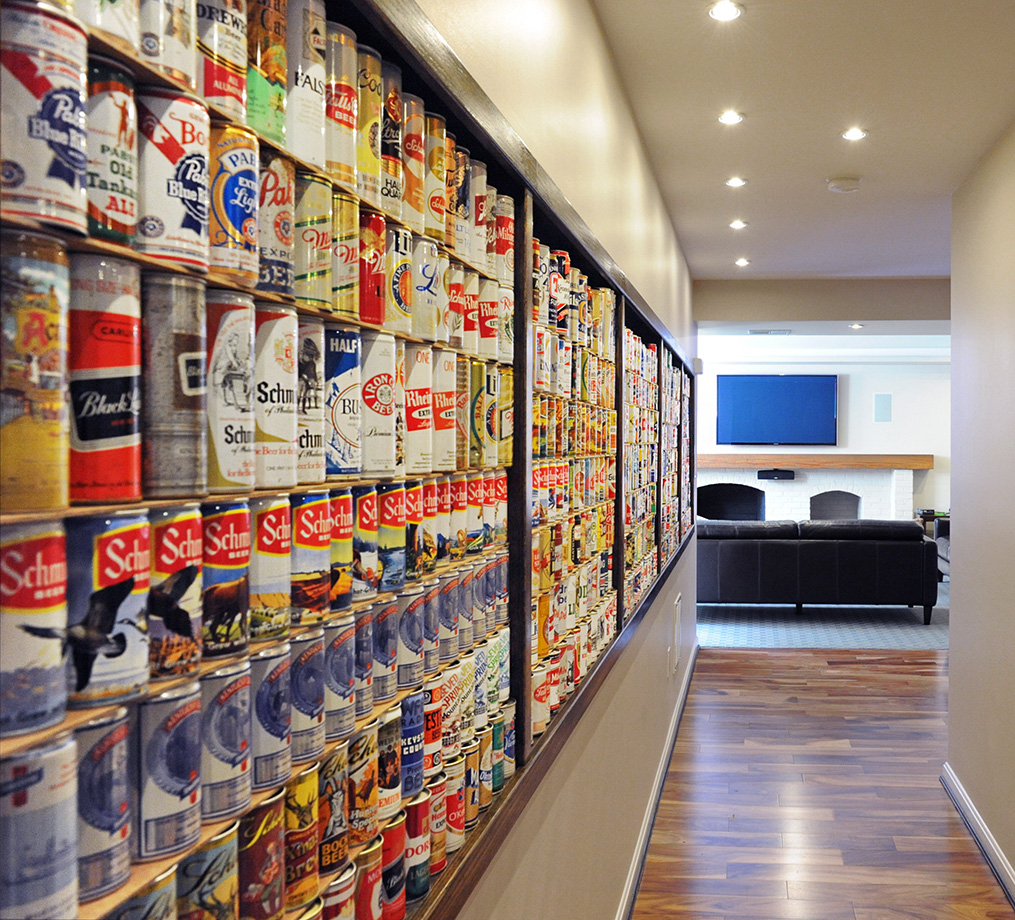 The wall of beer cans provides color and humor to this basement playroom