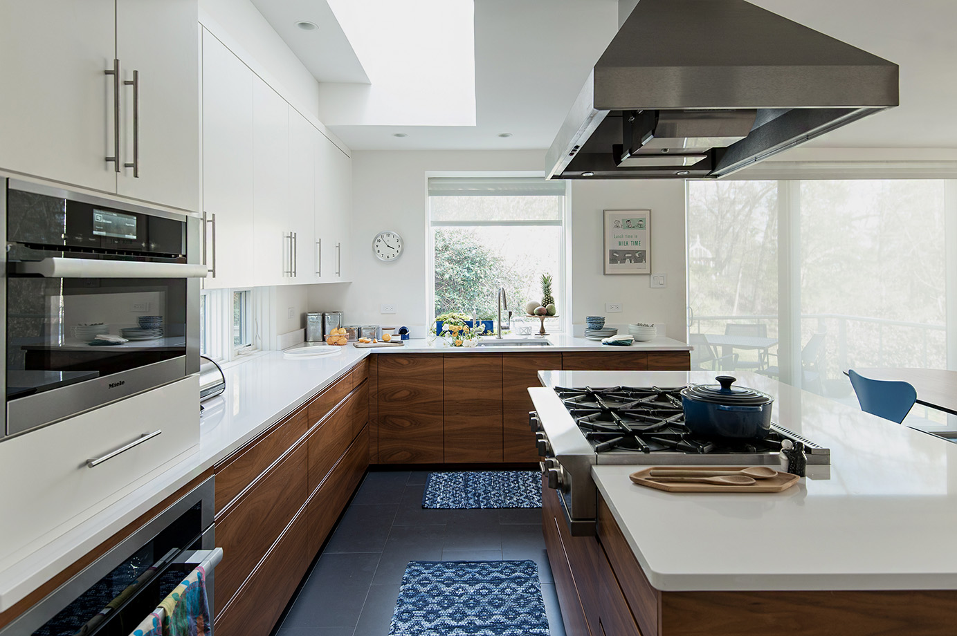 Wood, white and stainless steel styled kitchen